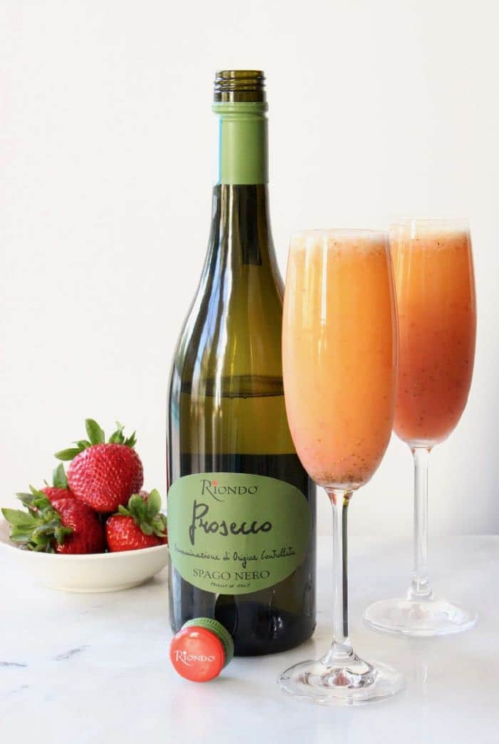 Strawberry Mimosa in Champagne Flutes with Prosecco Wine.